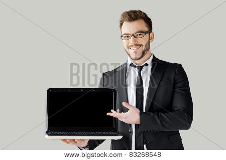 Pointing Copy Space On His Laptop.