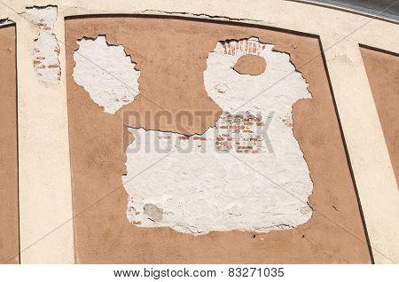 Peeling weathered plaster