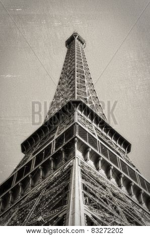 The Eiffel Tower in Paris, France. Vintage look: monochrome with sepia toning, scratches and film grain