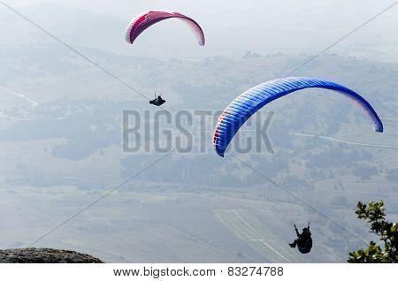 Paragliding above the mountain range
