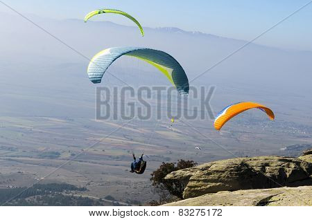 Paragliders taking off the high mountain