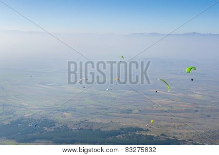 Paragliding competition against blue sky, extreme sport