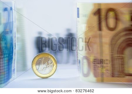 Euro Currency And People Silhouettes