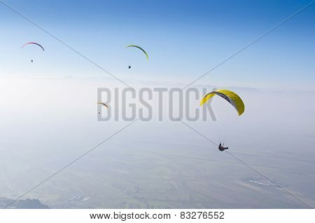Paragliding against the blue sky
