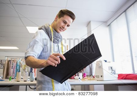 Student looking notebook of pictures at the college