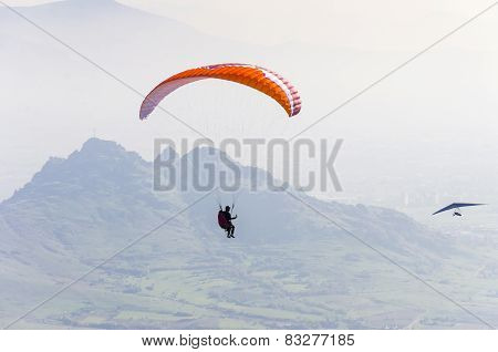 Paragliding above mountain range