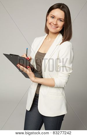 Businesswoman in white jacket write on clipboard