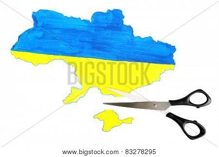 Map of Ukraine and scissors, isolated on white- concept of disintegration of the country
