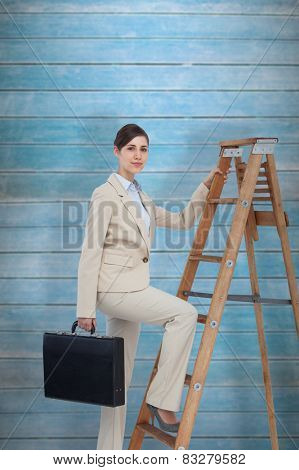 Businesswoman climbing career ladder with briefcase and looking at camera against wooden planks