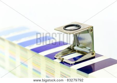 magnifying glass and color palette in printshop