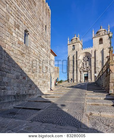 The Medieval Tower on the left and the Porto Cathedral seen through the Dom Pedro Pitoes Street. Romanesque and Gothic architecture. Porto, Portugal. Unesco World Heritage Site