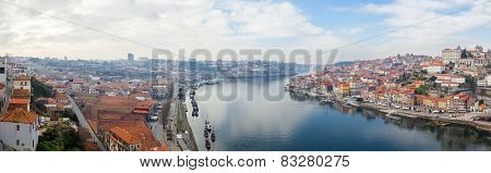 Panorama of the historical Ribeira District and Douro River in the city of Porto, as well the Vila Nova de Gaia Port Wine Cellars and Rabelo Boats in Portugal during sunset. Unesco World Heritage Site