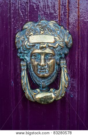 brass Door Knocker on a purple door