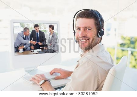 Work team having a meeting together against businessman in headset smiling at camera