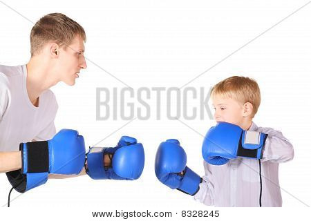 father and his son is boxing with boxing gloves. isolated.