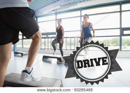 The word drive and trainer stepping with aerobics class against badge