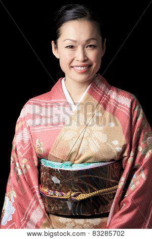 A Beautiful japanese kimono woman in black background