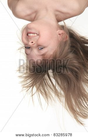 A Young girl upside down in studio white background