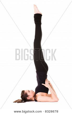 Young Woman Stretching, Wears Black, Isolated On White