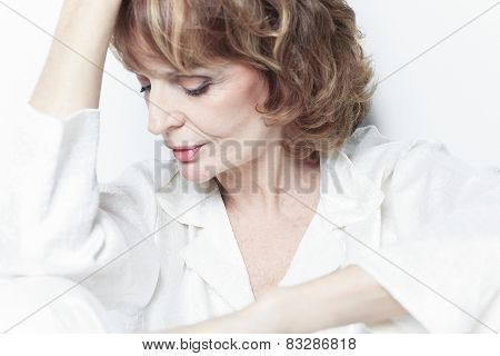 A sad portrait of senior woman in studio