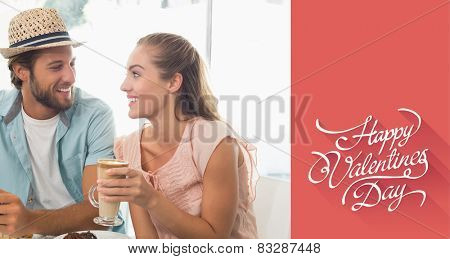 Happy couple enjoying coffee and cake against happy valentines day