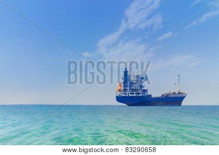 Tanker ship on open sea at sunrise