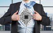 stock photo of microchips  - businessman opens his shirt with drawing of microchip - JPG