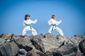 picture of karate kid  - Children training karate on the stone coast - JPG