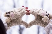 picture of knitwear  - Heart shape made of hands wearing knitwear gloves outdoors - JPG