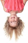 pic of upside  - Little beautiful girl in pink clothes upside down isolated on white - JPG