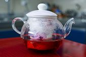 stock photo of kettles  - a kettle with tea flowers roses in the kitchen - JPG