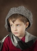 image of little boys only  - Portrait of a little boy on a brown background - JPG