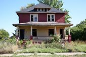 stock photo of derelict  - Abandoned two family house in a run down neighborhood - JPG