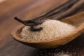 picture of vanilla  - vanilla sugar and vanilla beans on wooden spoon - JPG