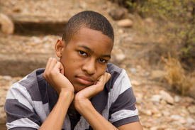 stock photo of teenage boys  - Sad African - JPG