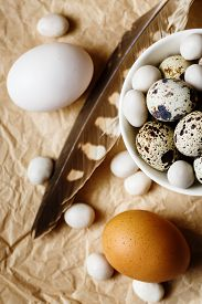 stock photo of quail egg  - Food background with quail eggs and hen eggs - JPG