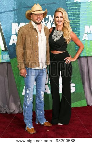 NASHVILLE, TN-JUN 10: Singers Jason Aldean (L) and wife Brittany Kerr attend the 2015 CMT Music Awards at the Bridgestone Arena on June 10, 2015 in Nashville, Tennessee.