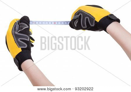 Hands In Protective Glowes With Measuring Tape