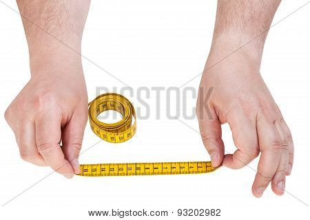 Male Hands With Tailor Measuring Tape Isolated