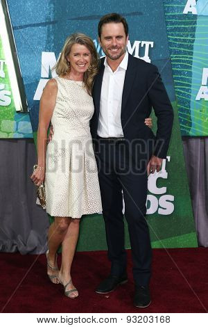 NASHVILLE, TN-JUN 10: Actor Charles Esten (R) and wife Patty Hanson attend the 2015 CMT Music Awards at the Bridgestone Arena on June 10, 2015 in Nashville, Tennessee.