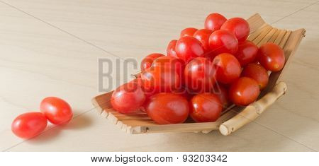 Fresh Red Grape Tomatoes On Small Boat