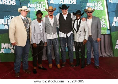 NASHVILLE, TN-JUN 10: NFL player JJ Watt (C) attends the 2015 CMT Music Awards at the Bridgestone Arena on June 10, 2015 in Nashville, Tennessee.