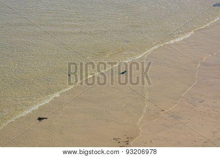 Sea Water On Sandy Beach In Cornwall, England