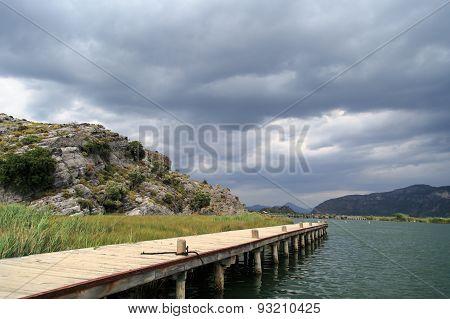 Pier In River