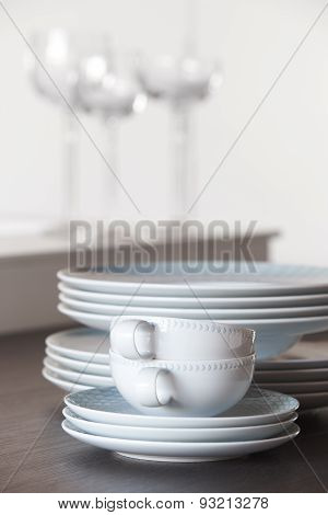 Crockery Set Over A Table And Cups With White Background