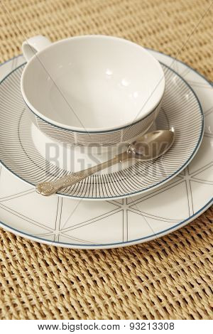 Retro Tea Or Coffee Cup With Tablecloth And Spoon Detail