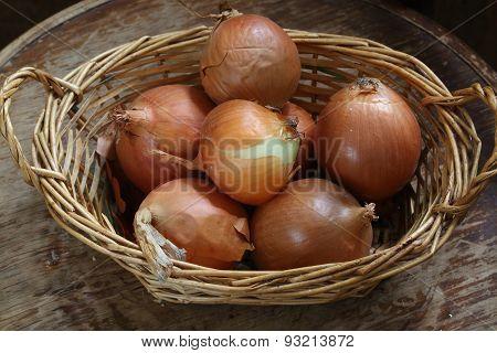 Onions bulbs in a wattled basket,