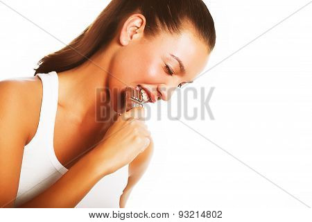 young woman biting chocolate