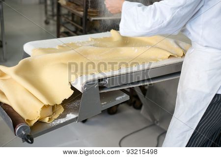 Sprinkling Flour On Sheet Of Pie Dough