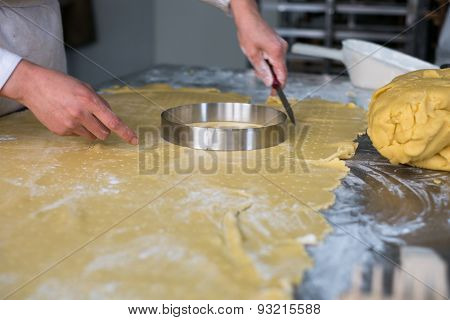 Pastry Chef Cutting Pie Dough